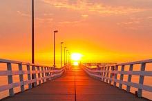 Timmendorfer Strand Steg mit Sonnenuntergang JustAway