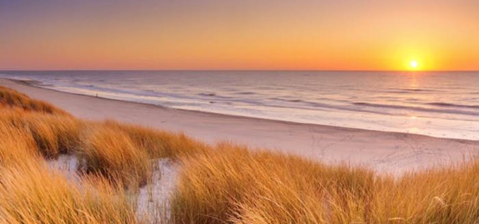 huisduinen strand sonnenuntergang